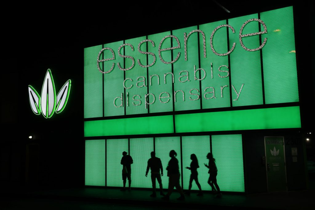 People stand outside after shopping at the Essence cannabis dispensary in Las Vegas.