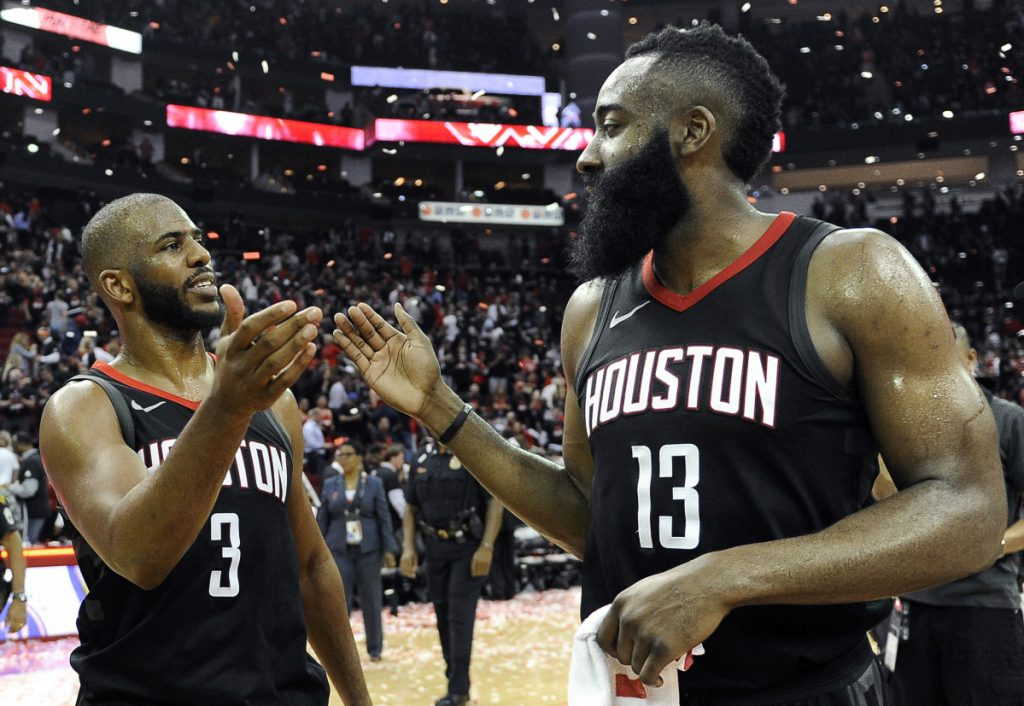 Houston's Chris Paul, right, and James Harden celebrate the Rockets win over the Utah Jazz on Tuesday in Houston.