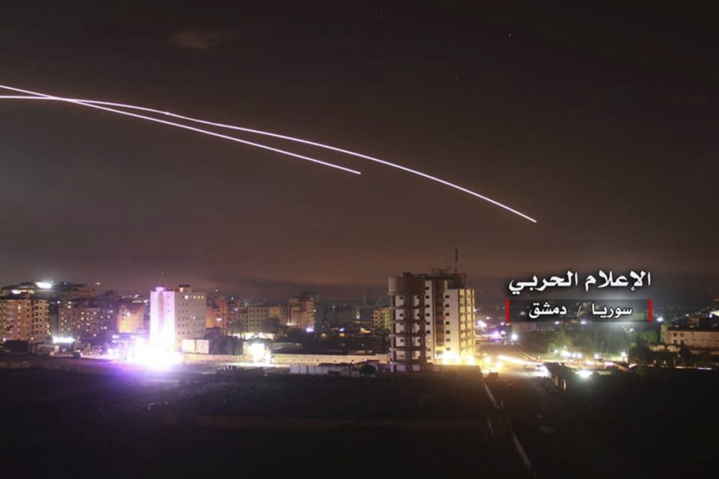 """Israeli missiles rise into the sky as they head for air defense positions and other military bases, in Damascus, Syria, in a photo provided Thursday. The Israeli military on Thursday said it attacked """"dozens"""" of Iranian targets in neighboring Syria in response to an Iranian rocket barrage on Israeli positions in the Golan Heights."""