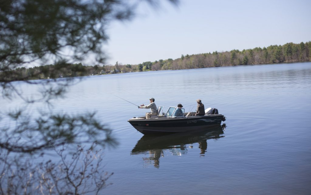 George Smith Casts His Line While Fishing With Friend Ed Pineau On Webber Pond In