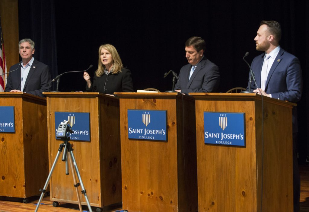The Republican gubernatorial candidates for 2018 – from left, businessman Shawn Moody of Gorham; former Health and Human Services Commissioner Mary Mayhew of South China; House Minority Leader Ken Fredette of Newport; and Senate Majority Leader Garrett Mason of Lisbon – participate in a forum at St. Joseph's College in Standish.