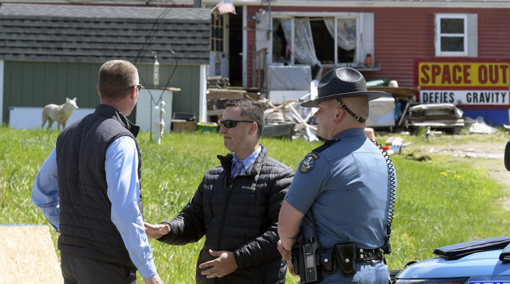 Maine State Police stand outside a mobile home in Wales on Monday where 54-year-old William N. Derick, who lived in there at 485 Pond Road, was shot and killed by State Trooper James MacDonald.