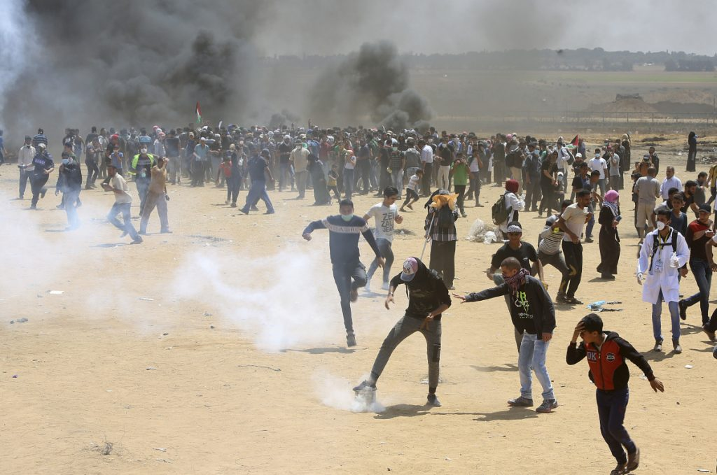 Palestinian protesters burn tires Monday near the Israeli border fence, east of Khan Younis, in the Gaza Strip.