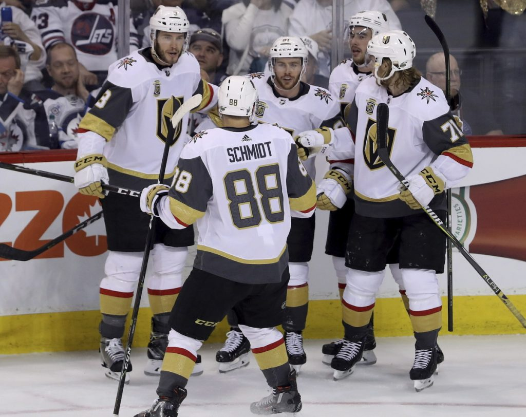 Vegas players gather to celebrate after a goal by Jonathan Marchessault, center, during the Golden Knights' 3-1 win in Game 2 of the Western Conference finals on Monday.