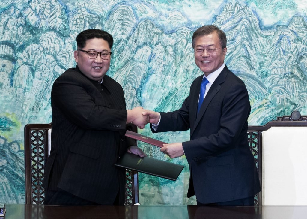 North Korean leader Kim Jong Un, left, and South Korean President Moon Jae-in shake hands in April after signing a joint statement at the border village of Panmunjom in the Demilitarized Zone, South Korea. A meeting planned for Wednesday between representatives of the two countries has been canceled.