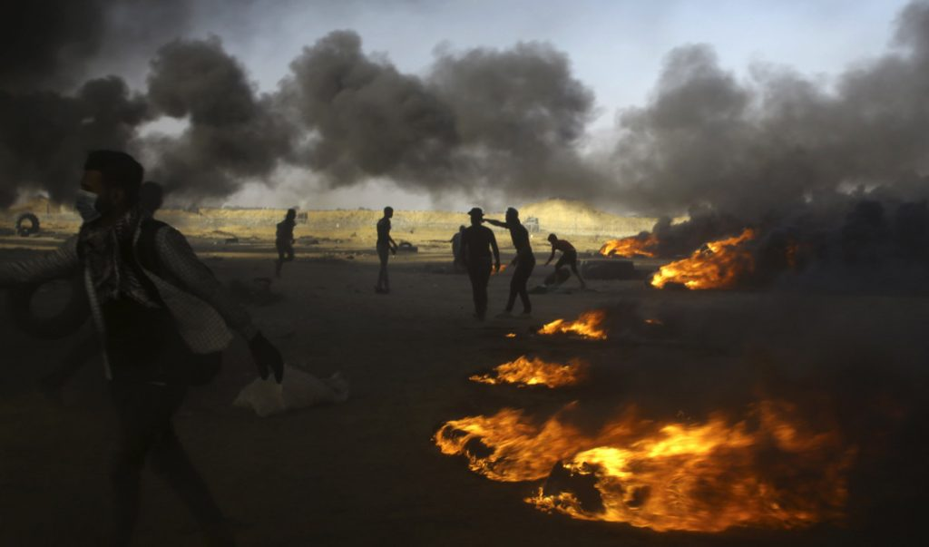 Palestinian protesters burn tires during a protest at the Gaza Strip's border with Israel on Tuesday.