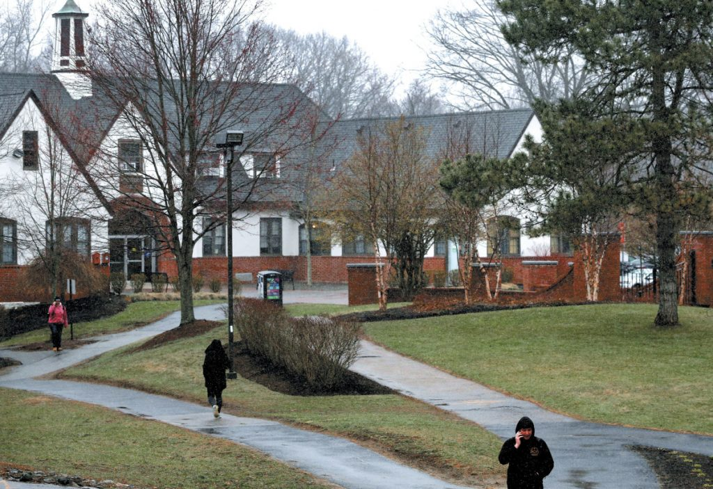 """Students walk on the campus of Mount Ida College in Newton, Mass. """"Did we go out and announce, 'Hello ... we're teetering on the brink of insolvency'? ... No,"""" a school official says."""