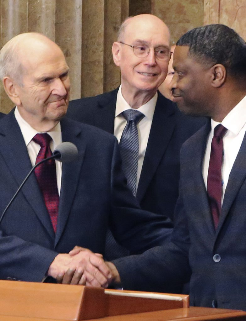 Mormon church President Russell M. Nelson shakes hands with Derrick Johnson, president of the NAACP, during a news conference Thursday in Salt Lake City.
