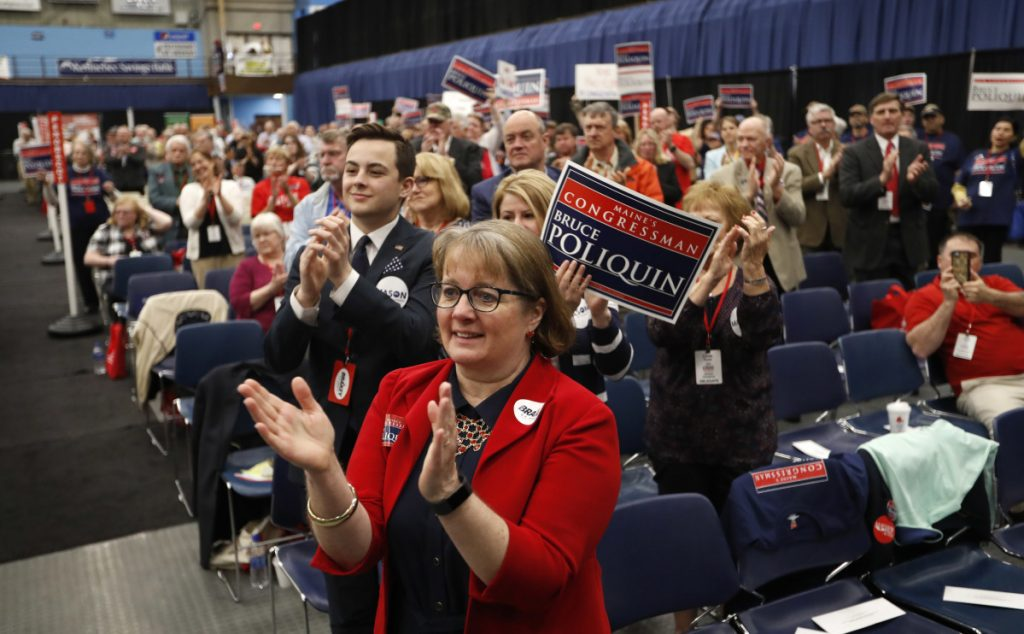 Maine State Rep. Stacey K. Guerin, R-Glenburn, applauds U.S. Rep. Bruce Poliquin during the Republican Convention on May 5 in Augusta.