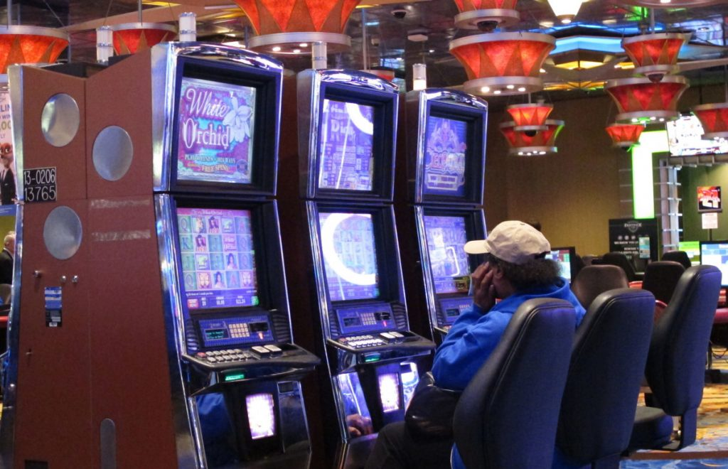 A woman plays a slot machine in Atlantic City, N.J. Organizations that fight gambling addiction say most states are ill-prepared for a wave of problem gamblers likely to be triggered by a recent Supreme Court ruling on sports betting.