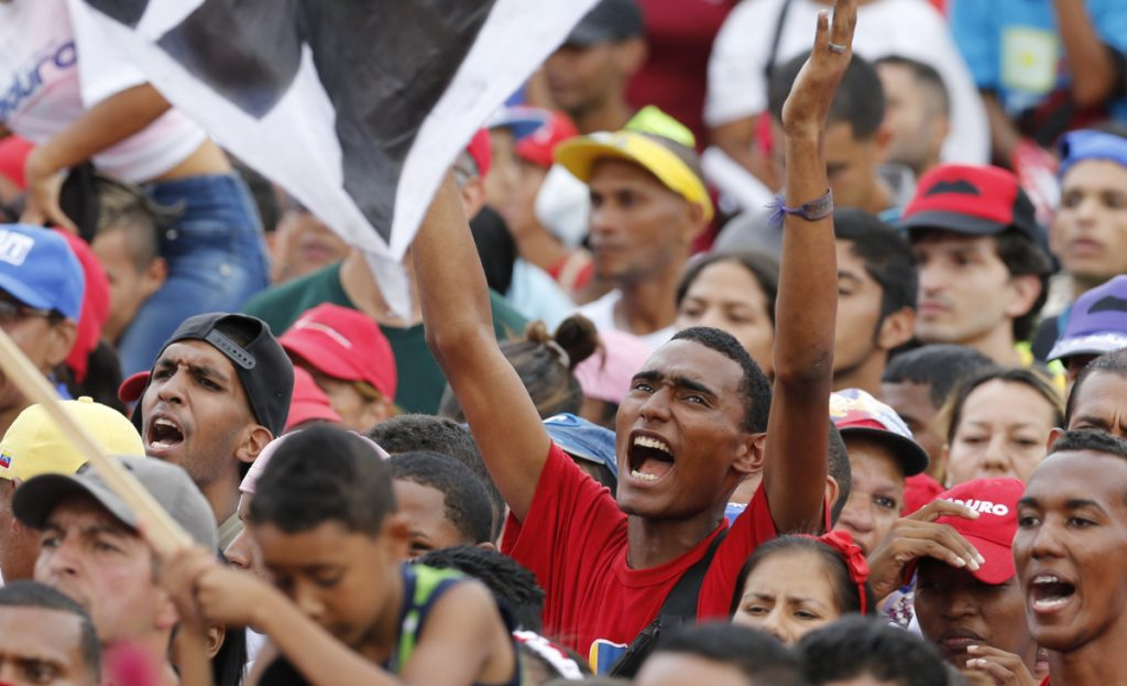 Supporters of Venezuela's President Nicolas Maduro attend his closing campaign rally in Caracas on Thursday.
