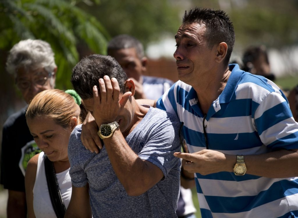 Relatives of passengers who died in Cuba's worst aviation disaster arrive at the morgue, in Havana on Saturday. Doctors say the three survivors are in grave condition.