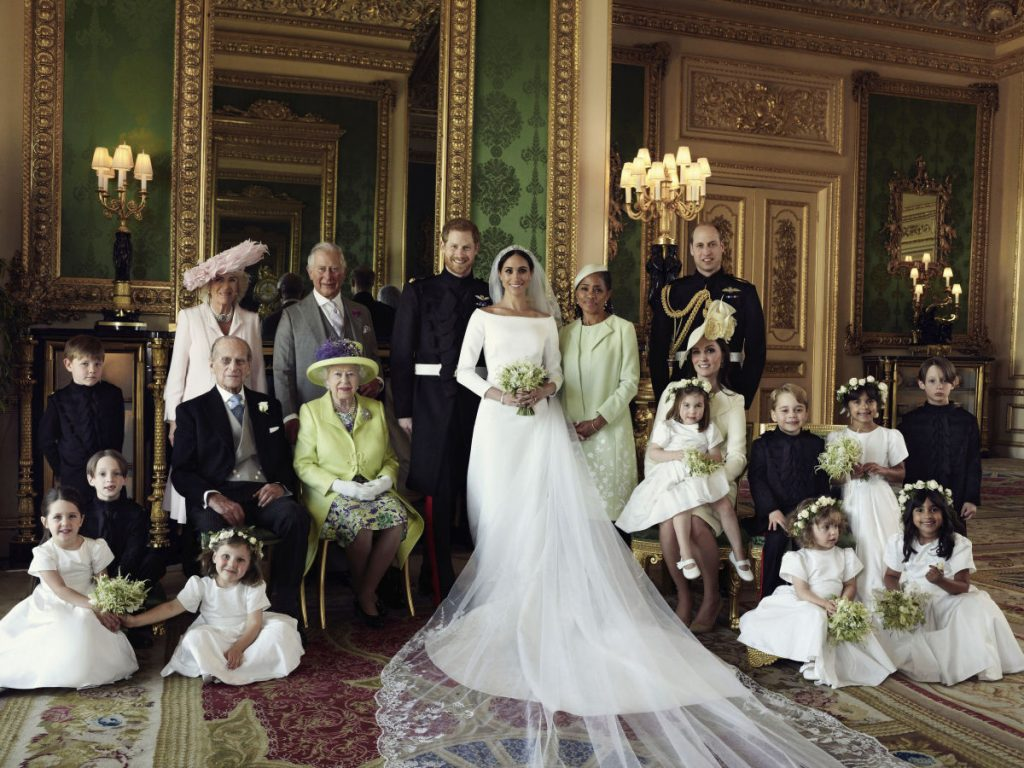 An official wedding photo of Britain's Prince Harry and Meghan Markle, center taken at Windsor Castle on Saturday. Others in photo from left, back row, Jasper Dyer, Camilla, Duchess of Cornwall, Prince Charles, Doria Ragland, Prince William; center row, Brian Mulroney, Prince Philip, Queen Elizabeth II, Kate, Duchess of Cambridge, Princess Charlotte, Prince George, Rylan Litt, John Mulroney; front row, Ivy Mulroney, Florence van Cutsem, Zalie Warren, Remi Litt.