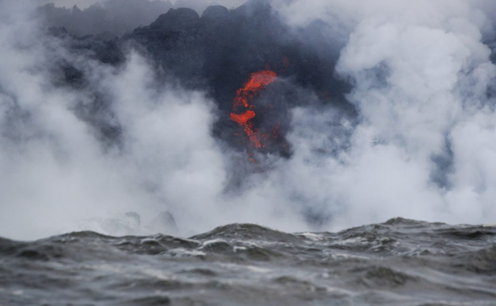 Lava flows into the ocean near Pahoa, Hawaii, on Sunday. Kilauea volcano on Hawaii's Big Island has gotten more hazardous in recent days, with rivers of molten rock pouring into the ocean and flying lava causing the first major injury.