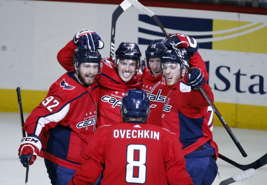 Washington's Alex Ovechkin joins teammates Evgeny Kuznetsov, left, T.J. Oshie, center Nicklas Backstrom, and John Carlson, right, as they celebrate a goal Monday in Washington.