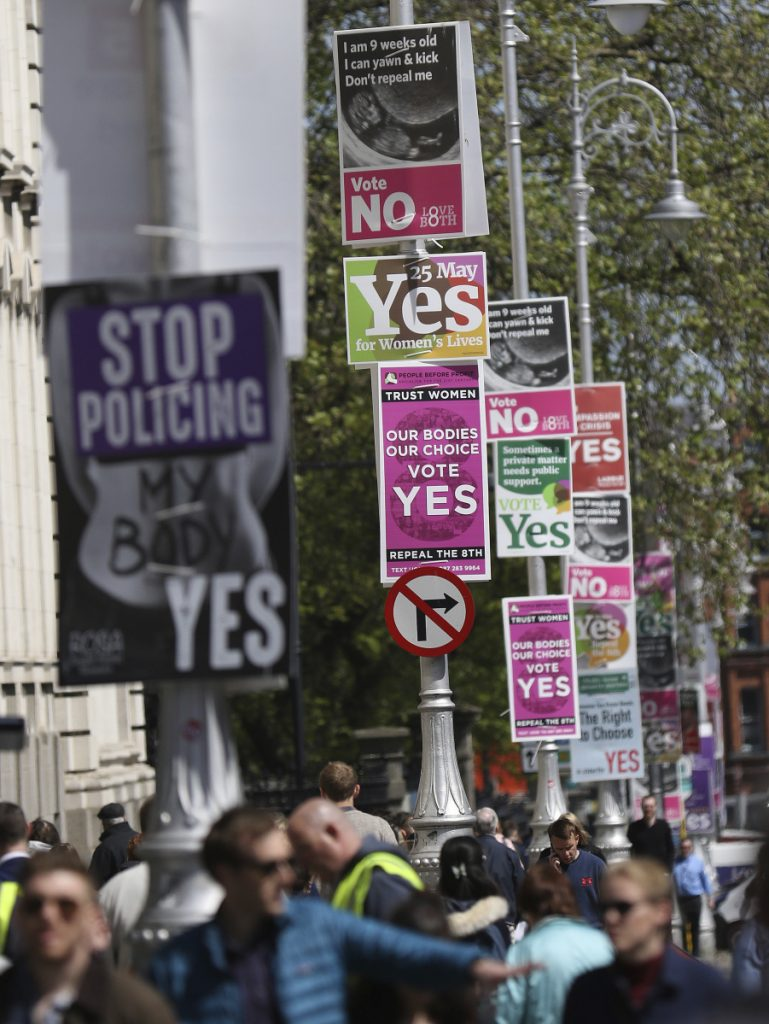 Pro- and anti-abortion posters are displayed on lampposts outside government buildings in Dublin, Ireland, on May 17. Irish voters went to the polls Friday to decide whether to repeal a constitutional ban on abortion.