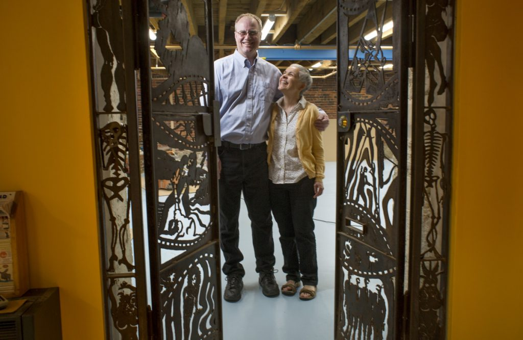 Rick Lowell and Laura O'Meara, who have run Casablanca Comics for more than 30 years, stand in their new space on Middle Street in Portland, which was formerly occupied by Videoport. They founded the Maine Comics Arts Festival in 2009.
