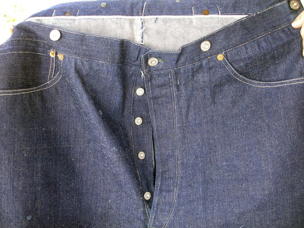 This pair of 125-year-old blue jeans sold for nearly $100,000 to a buyer in Asia, a Lisbon Falls auction house says.
