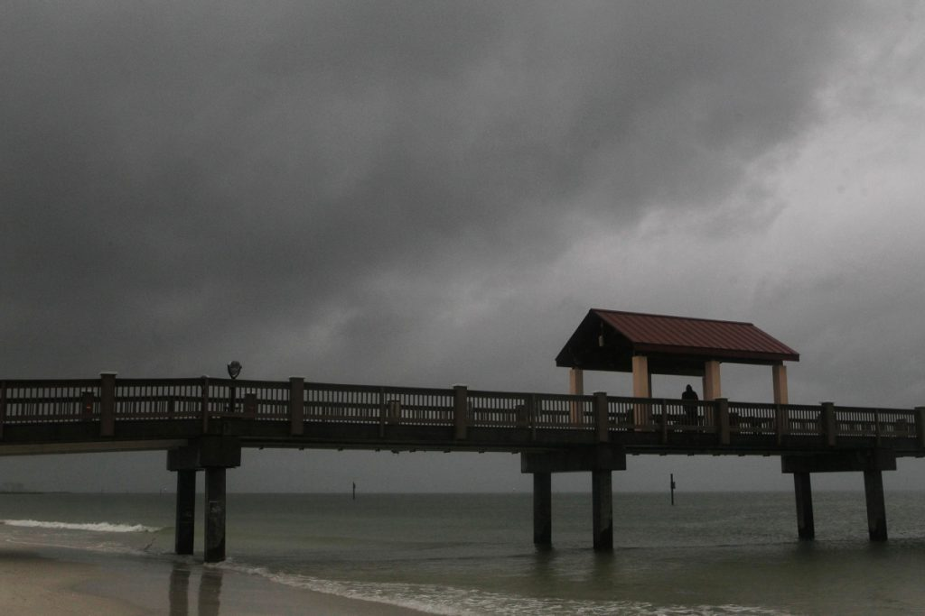 Rain falls on Clearwater Beach by Pier 60 early Sunday as Subtropical Storm Alberto looms in the Gulf to the southwest.   Jim Damaske/Tampa Bay Times via AP