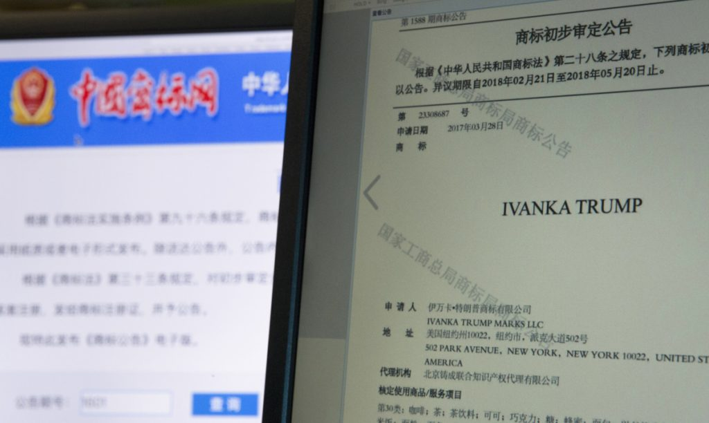 A computer screen displays an announcement on the Chinese Trademark Office website approving the Ivanka Trump trademark to be used in a wide variety of products.
