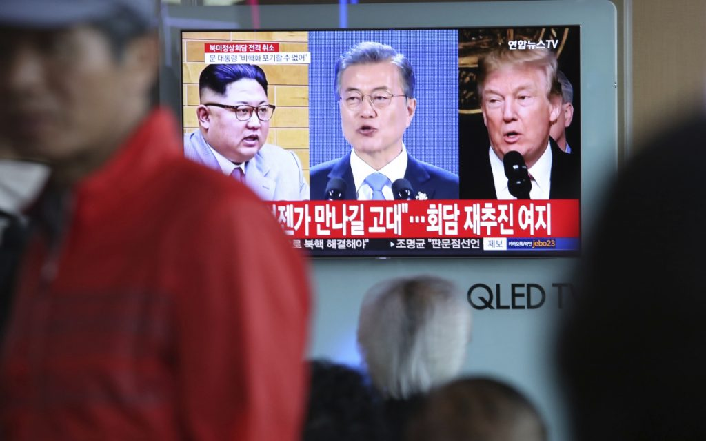 A TV screen shows images of President Trump, right, South Korean President Moon Jae-in and North Korean leader Kim Jong Un, left, during a news program at the Seoul Railway Station in Seoul, South Korea.