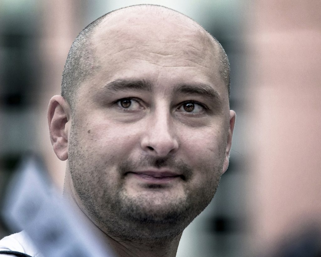 Arkady Babchenko, shown in a 2013 photo, was reported shot and killed Tuesday, but showws up at a news conference Wednesday very much alive.