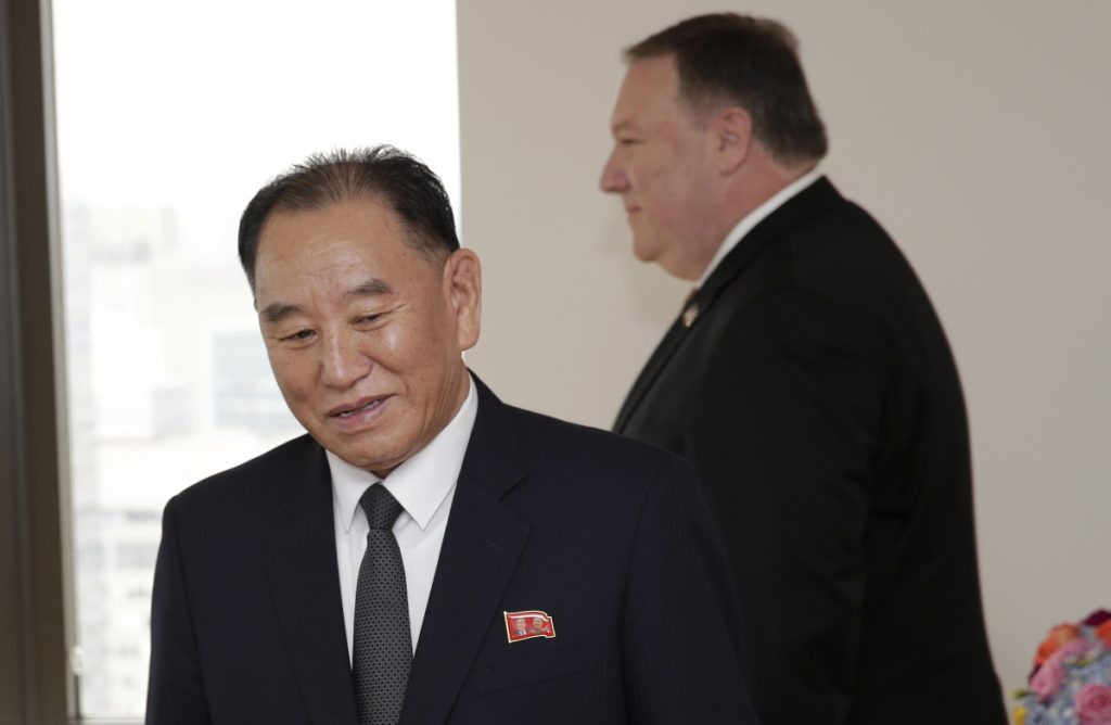 Kim Yong Chol, former North Korean military intelligence chief and one of Kim Jong Un's closest aides, and U.S. Secretary of State Mike Pompeo take their places at the table before a meeting Thursday in New York.