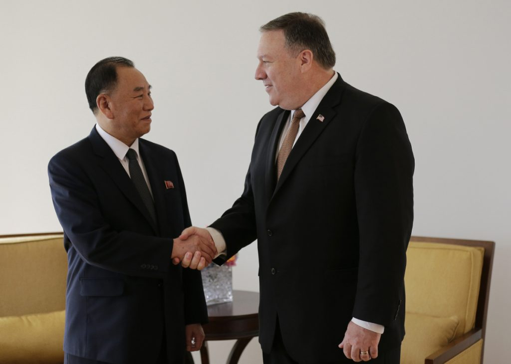 Kim Yong Chol, former North Korean military intelligence chief and one of leader Kim Jong Un's closest aides, shakes hands with U.S. Secretary of State Mike Pompeo during a meeting Thursday in New York.