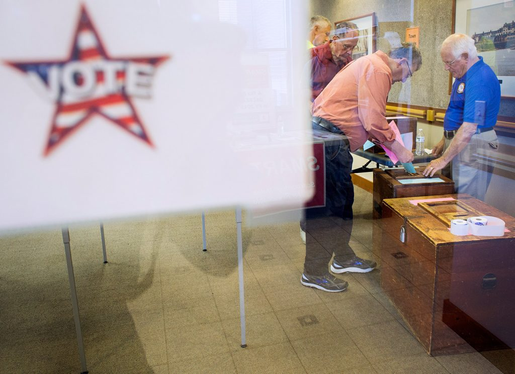 Volunteer Ralph Masciovecchio helps Roger Chabot cast his ballots in Tuesday's special recall election in Scarborough.