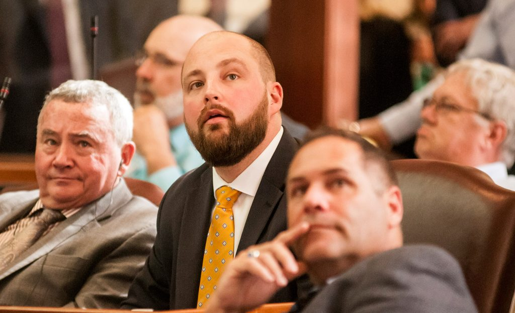 Rep. Matt Pouliot, R-Augusta, watches the vote tally board as his amendment for a one-day extension of the session goes down to defeat Wednesday.