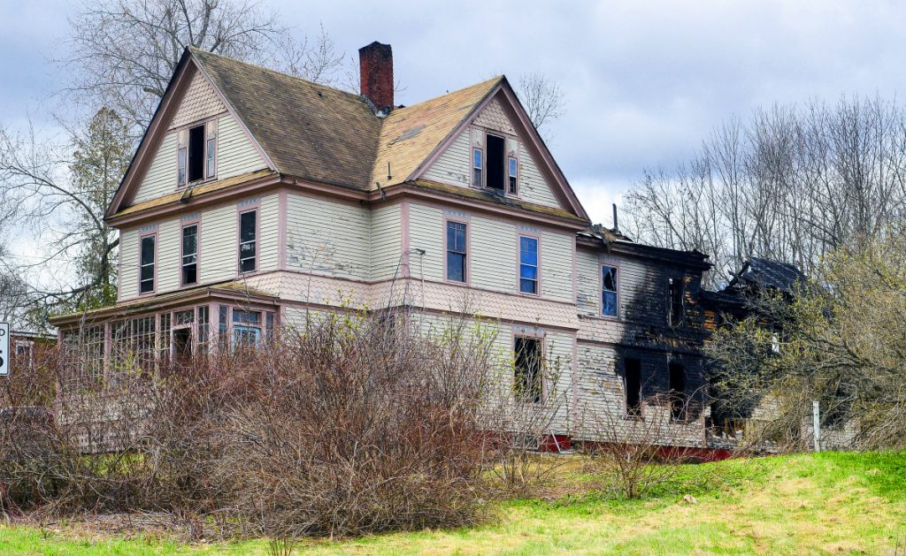 Damage is seen Tuesday at a large home at 10 West St. in Gardiner, a day after a fire broke out at the 128-year-old home. The cause of the fire remains under investigation.
