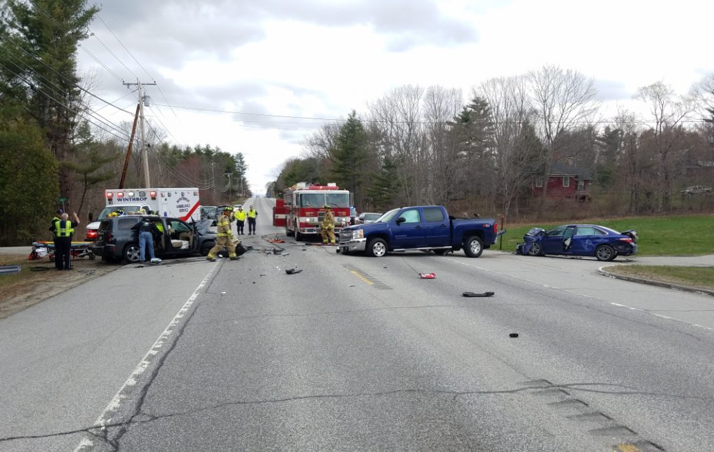 A Lewiston woman was badly injured after a three-car crash on U.S. Route 202 in East Winthrop on the afternoon of Monday.