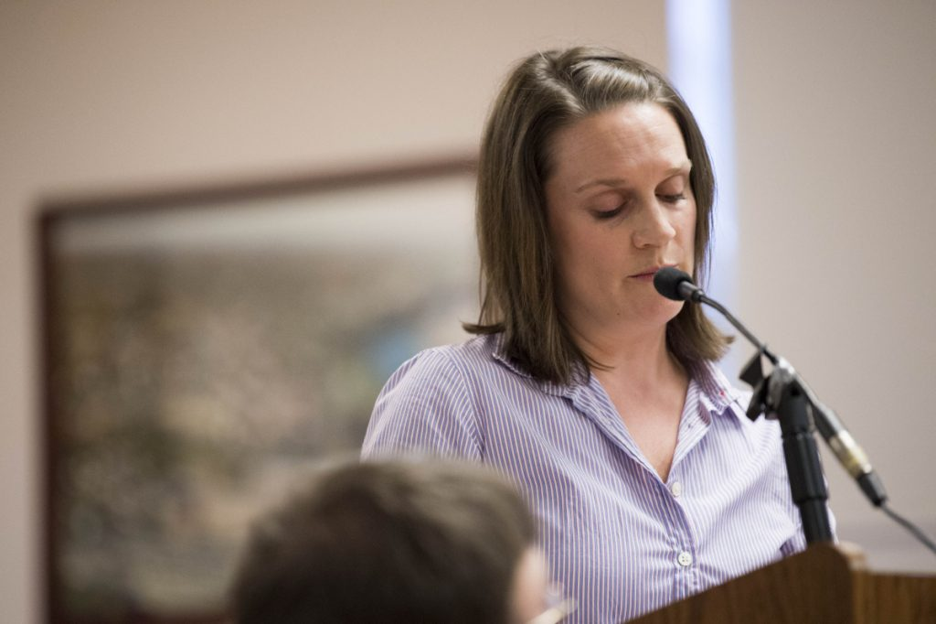 Amanda Isgro, wife of Mayor Nick Isgro, reads a prepared statement Tuesday evening at the beginning of a City Council meeting in the council chamber at The Center in Waterville. She defended her husband and blamed efforts to recall him as mayor on the Maine Democratic Party and the liberal advocacy group the Maine People's Alliance.