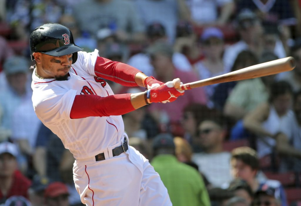 Boston Red Sox outfielder Mookie Betts hits his third home run of the game in the seventh inning Wednesday against the Kansas City Royals at Fenway Park in Boston.