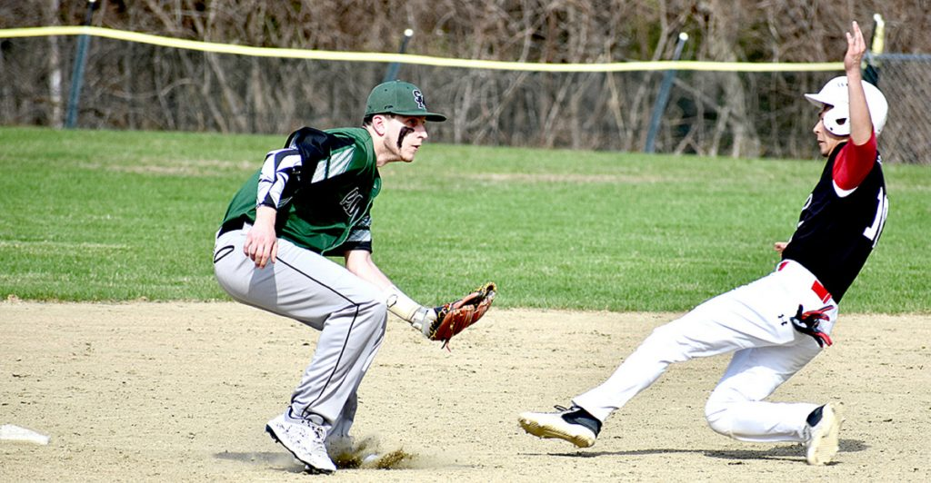 Spruce Mountain shortstop Nick Lombardi waits for the ball as Hall-Dale's Akira Warren slides into second base during a baseball game Wednesday at Griffin Field in Livermore Falls.