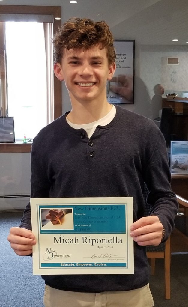 Micah Riportella received his New Dimensions Federal Credit Union scholarship certificate on April 26.