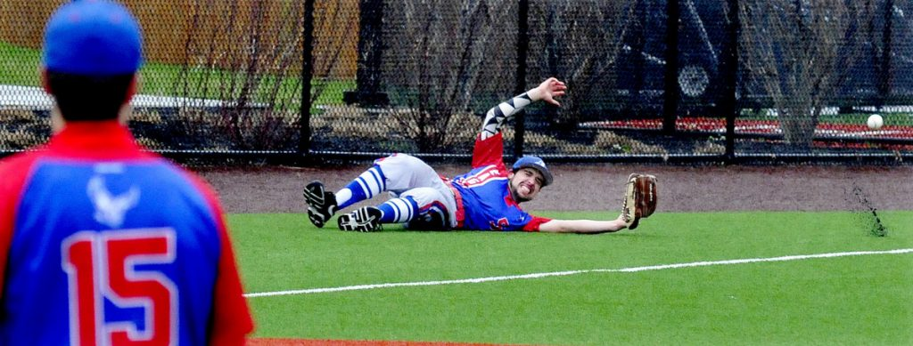 Messalonskee's Noah Tuttle slides to try and catch a ball during a game against Lawrence last season at Colby College.