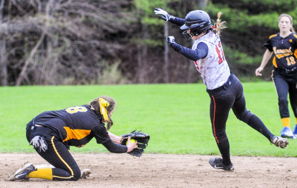 Marancook shortstop Amanda Goucher, left, has ball at second but Winslow baserunner Kaylee Jones goes around her to avoid the tag during a game Friday in Readfield.