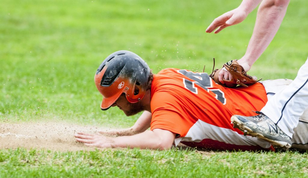 Winslow's Isaac Targett gets tagged out before he can make it back to third base as he was caught in a rundown against Maranacook on Friday in Readfield.