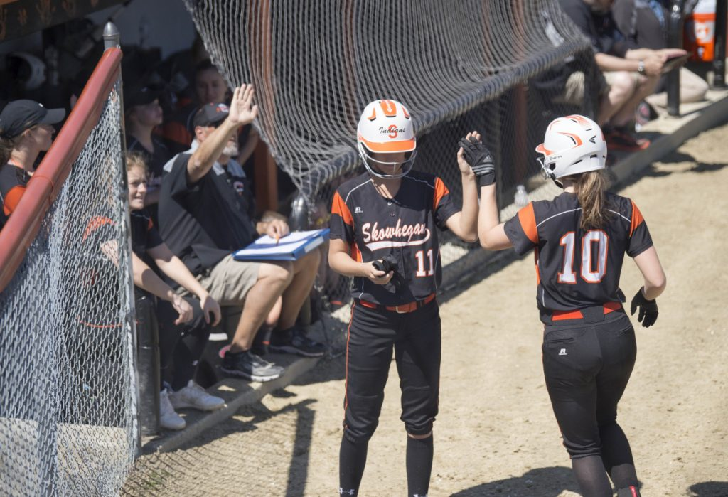 Skowhegan's Annie Cook (10) celebrates scoring a run against Messalonskee with teammate Alyssa Everett on Saturday in Skowhegan.