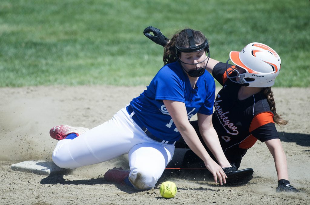 Skowhegan's Sydney Ames, right, slides safely into second base on a steal as Messalonskee shortstop Taylor Baker tries to handle the throw Saturday in Skowhegan.