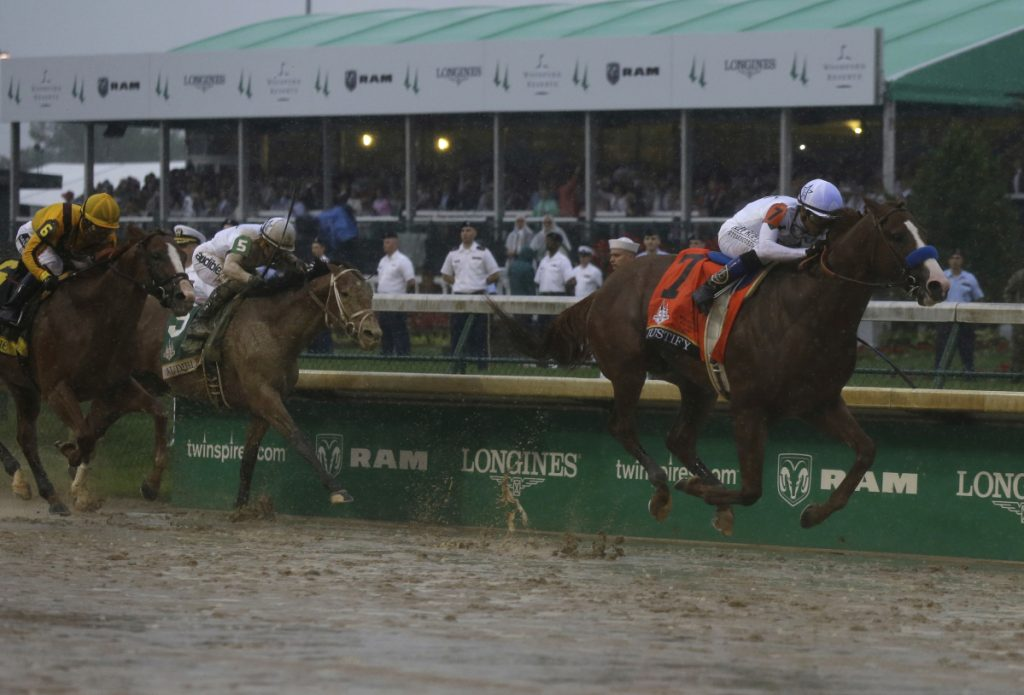 Mike Smith rides Justify to victory during the 144th running of the Kentucky Derby on Saturday at Churchill Downs in Louisville, Kentucky.