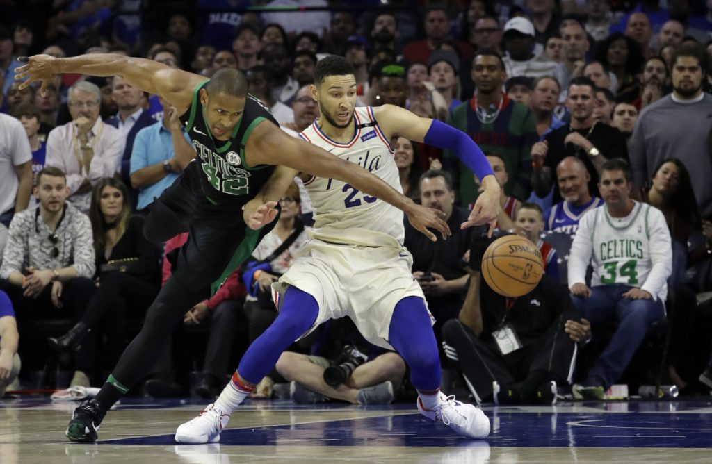 Boston's Al Horford, left, and Philadelphia's Ben Simmons chase the ball during the second half of Game 3 of a second-round playoff series Saturday in Philadelphia.