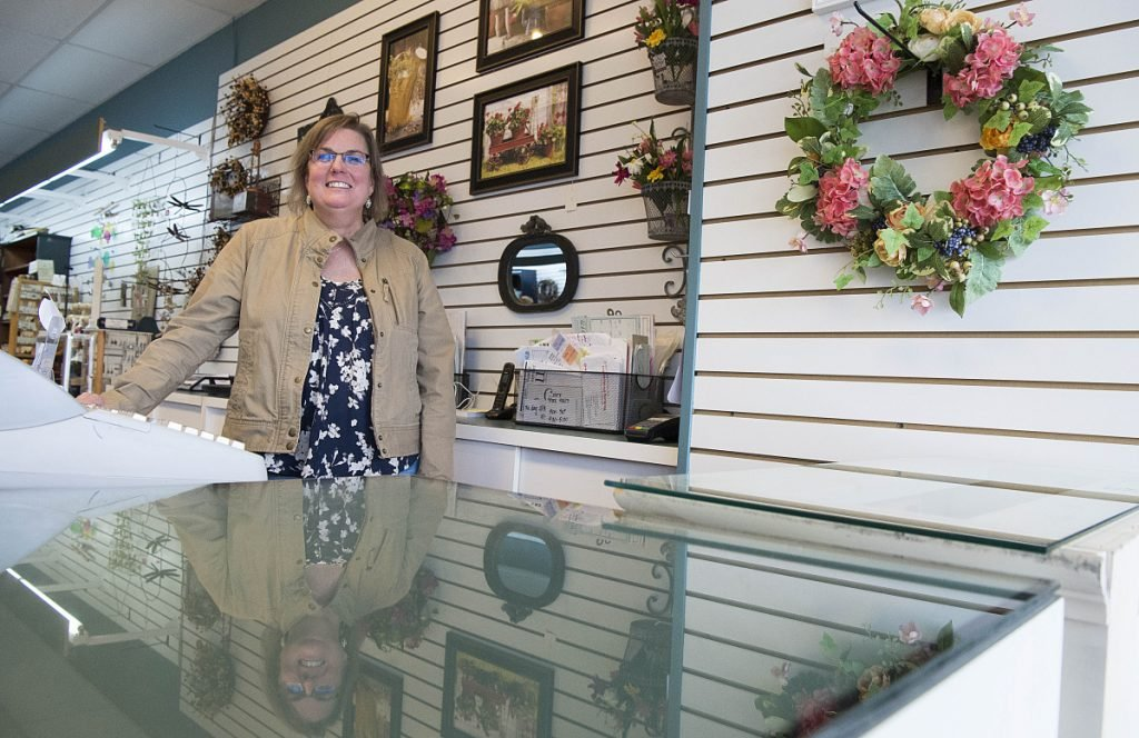 Paige Zirtidis, owner of Maine Made and More, stands for a portrait at the store's new location at The Concourse in downtown Waterville on Friday.
