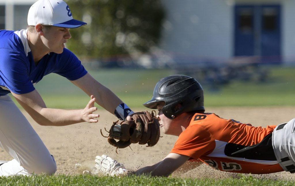 Erskine's Caden Turcotte can't apply the tag on third to Gardiner's Kolton Brochu during a game Monday in South China.
