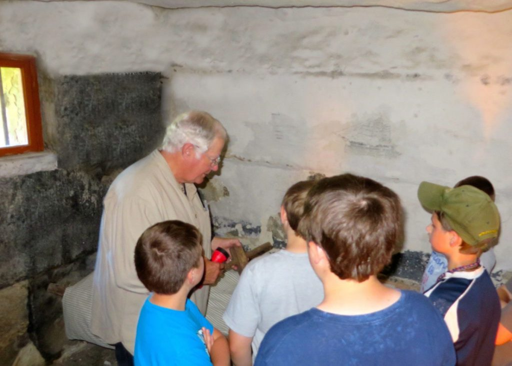Greg Shaw, a volunteer docent at the Old Jail in Wiscasset, helps young visitors imagine what it would like to be an inmate in the 1800s.