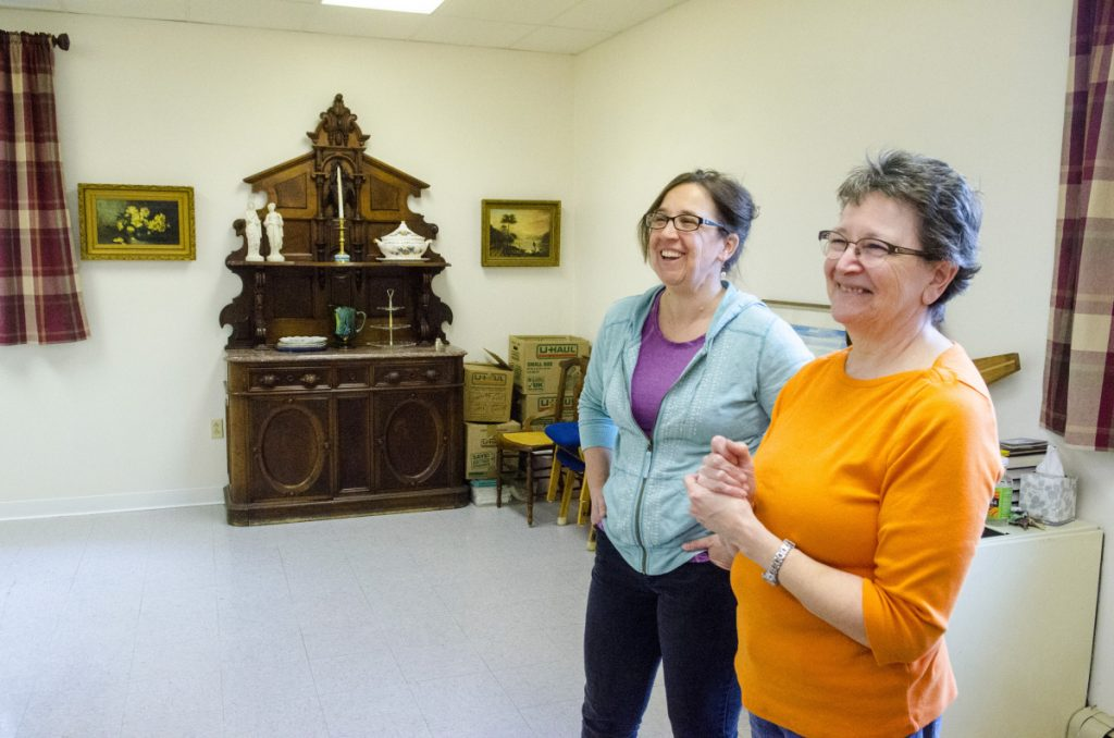 Sarah Miller, director of Bridging the Gap, left, and Betty Balderston, president of Emmanuel Lutheran Episcopal Church, talk about the where in the church Bridging the Gap could be located, pending Augusta Planning Board approval, during a tour April 28 in the church in Augusta.