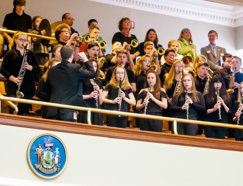 Band director Ben Clark leads the 32-member Winslow Junior High School Concert Band as it plays the national anthem April 13 to open the Maine House of Representatives morning session in the Maine State House in Augusta. The stage in the high school's auditorium in Winslow cannot accommodate the band and all its equipment, and a current renovation plan school officials are of developing would be expected to provide adequate space.