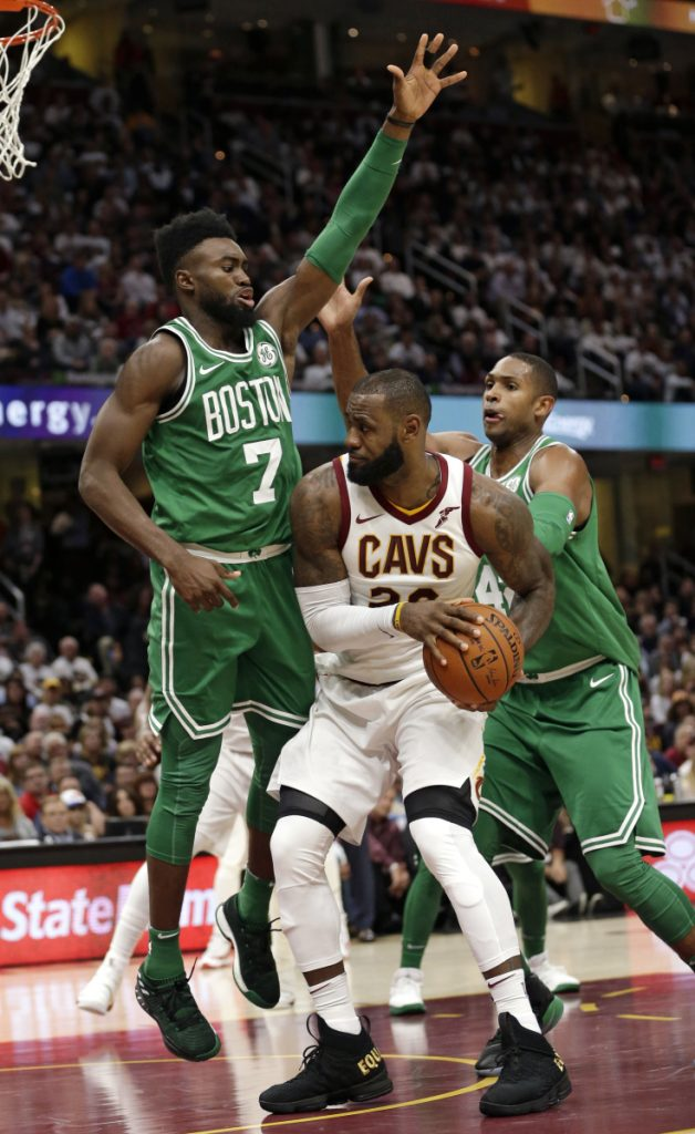 In this October 2017 photo, Cleveland's LeBron James (23) tries to get past Boston's Jaylen Brown (7) and Al Horford (42) in the second half of a gamein Cleveland. Although there were long stretches when it seemed impossible that the Cavaliers and Celtics would meet in the Eastern Conference finals, they're set to clash for the third time in four years.