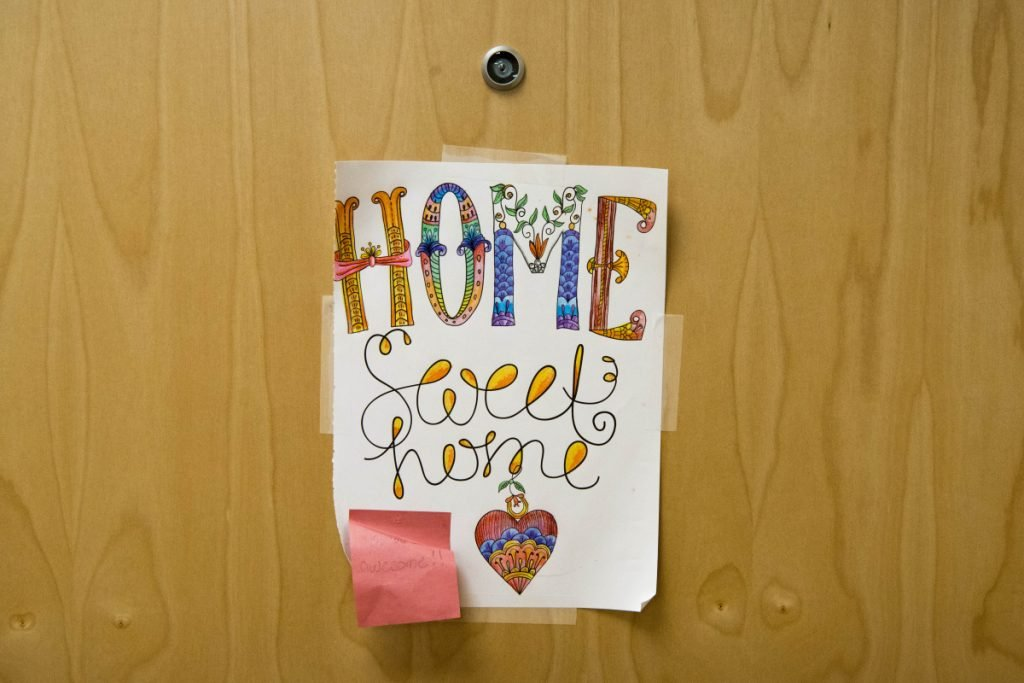 A sign hangs on the door Friday of one of the transitional apartments at the Mid-Maine Homeless Shelter in Waterville.